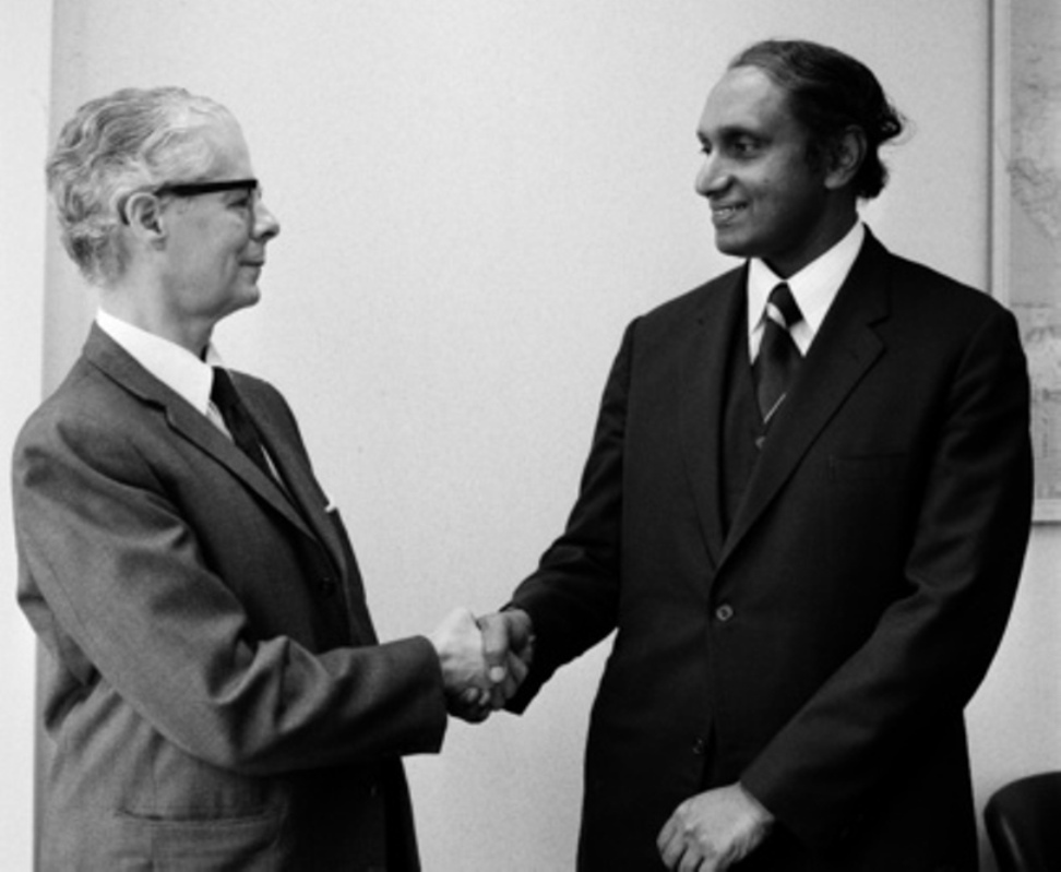 Gamani Corea (R) greets his predecessor at UNCTAD, Manual Perez-Guerrero, on 1 Feb 1974