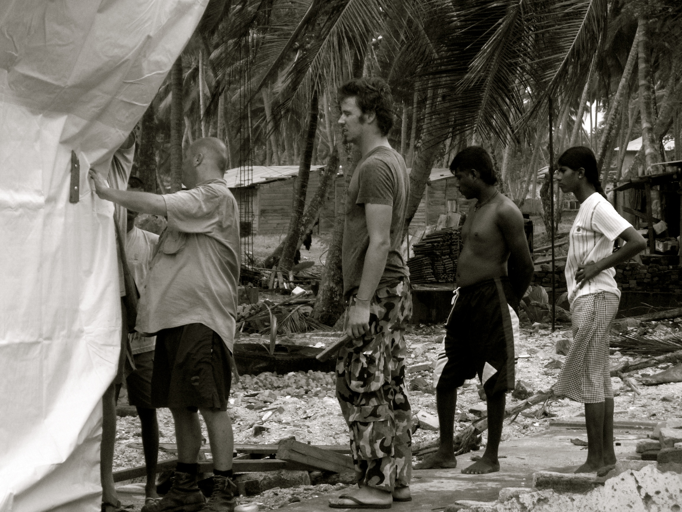 Volunteers building temporary shelters.